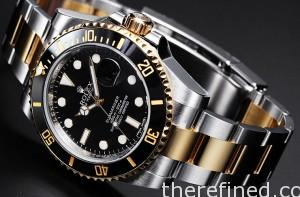 Rolex Submariner steel and gold with black bezel.